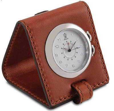 travel alarm clock in leather casing