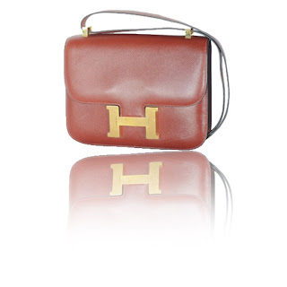 "Vintage 1970's burgundy brown Hermes constance bag with gold ""H"" hardware."