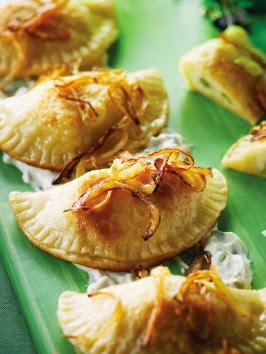 http://www.cookingchanneltv.com/recipes/nadia-g/pierogies-with-fixins.html