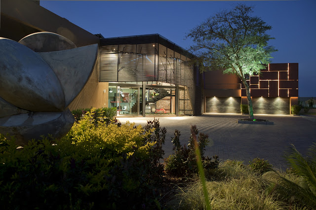 Front side of the modern house lit up at night