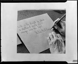 Helen Keller writing
