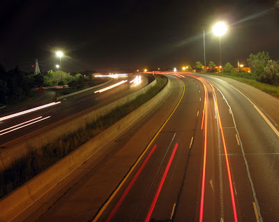 highway car tail lights, light streaks, long exposure at night