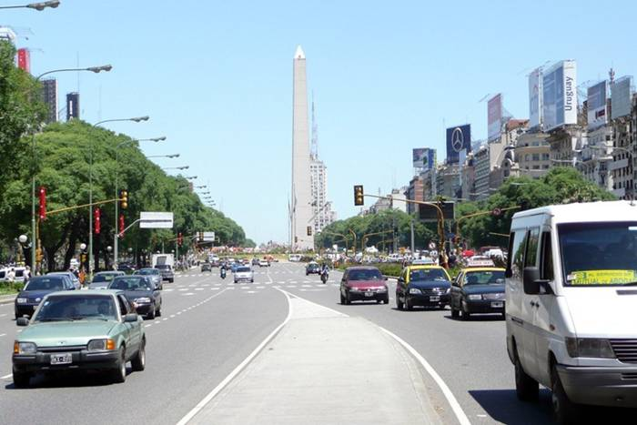 9 de Julio Avenue (or Avenida 9 de Julio, in the local tongue) in downtown Buenos Aires, Argentina, is not just any street. Nine lanes wide, with gardened medians between the opposing flow of traffic, this is the widest street in the world. Only those with a quick pace and long legs will be lucky to get to the other side before the traffic lights at the intersection changes. A pedestrian crossing this street usually requires a few extra minutes and two to three traffic light rotations. 9 de Julio Avenue is only 1 km long but 110 meters wide.
