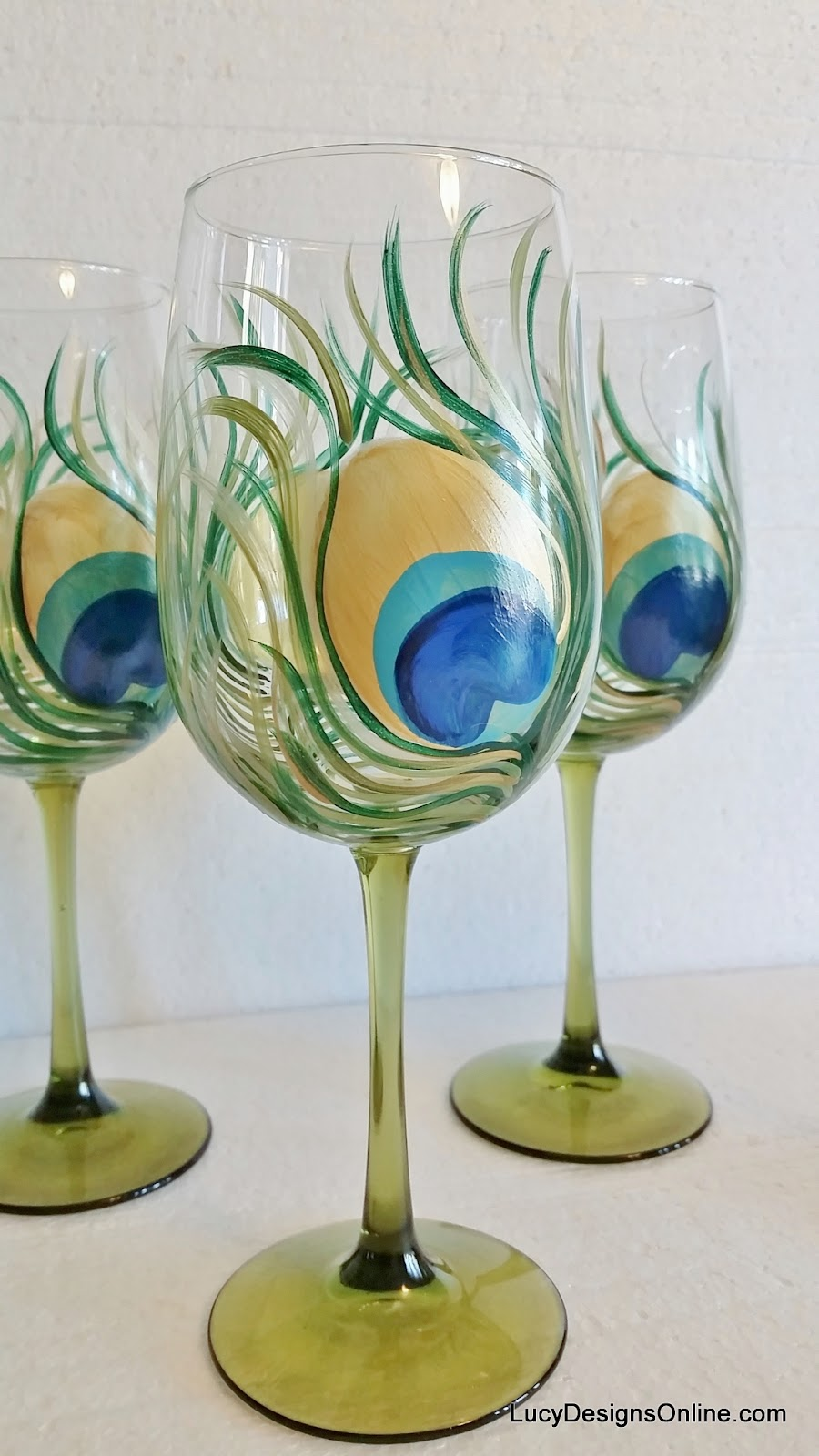 Diy hand painted wine glasses with peacock feather design for Homemade glass painting designs