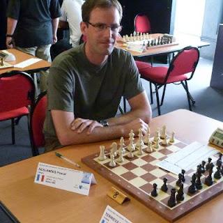 Pascal Deslandes réalise sa norme de MI une ronde avant la fin du tournoi © Chess & Strategy