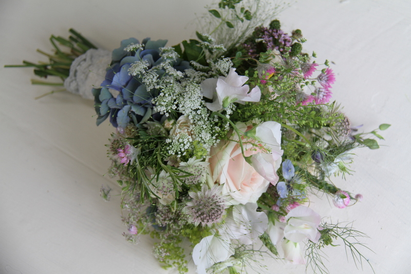 Wild Flower Wedding Bouquet In Shades Of Pinks And Blues With A Soft