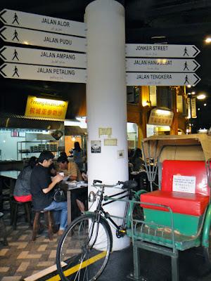 Malaysian Food Street Sign and Rickshaw at Sentosa