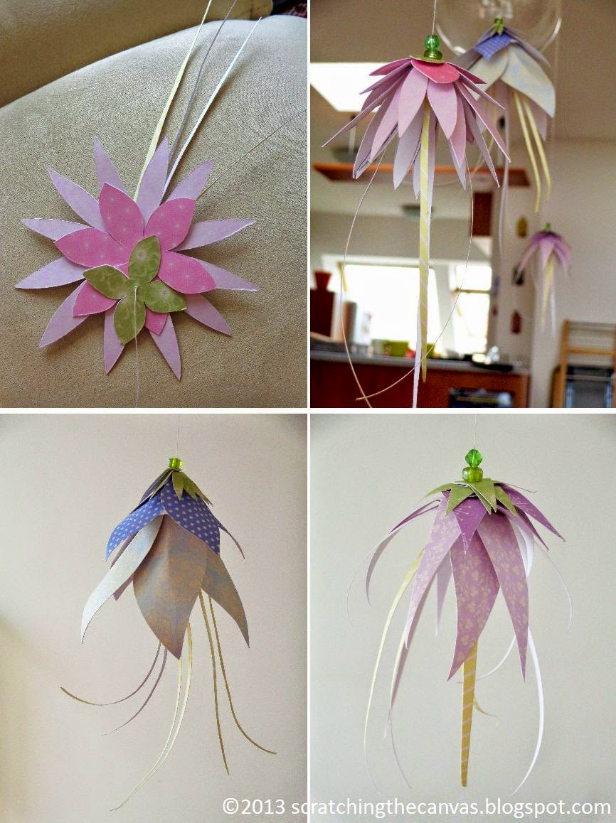 Scratching the canvas hanging paper flowers or jelly fish hanging flower decorations they are supposed to be inspired by fuschias but ended up looking a bit like jelly fish especially from a distance mightylinksfo