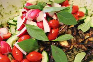 Soba noodles with grilled eggplant, radishes, tomatoes, cucumbers, and Thai basil