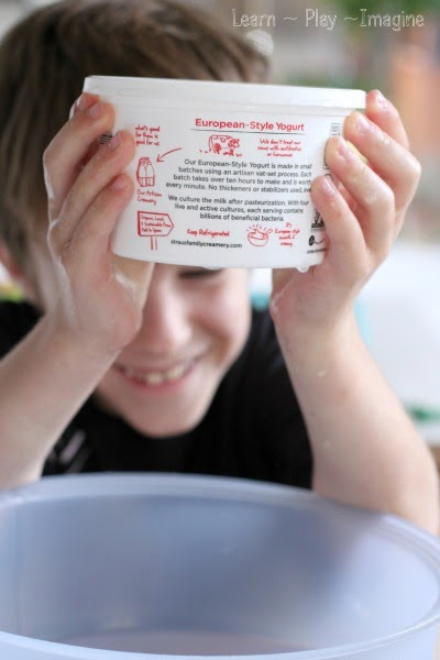Water pressure science for kids - How come water isn't dripping out of the holes on the bottom of this container?