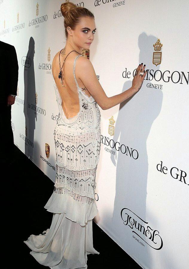 Cara y Roberto Cavalli. Collar espalda Cara en Cannes. Grisogono joyas. Colgante Espalda Cara Delavigne