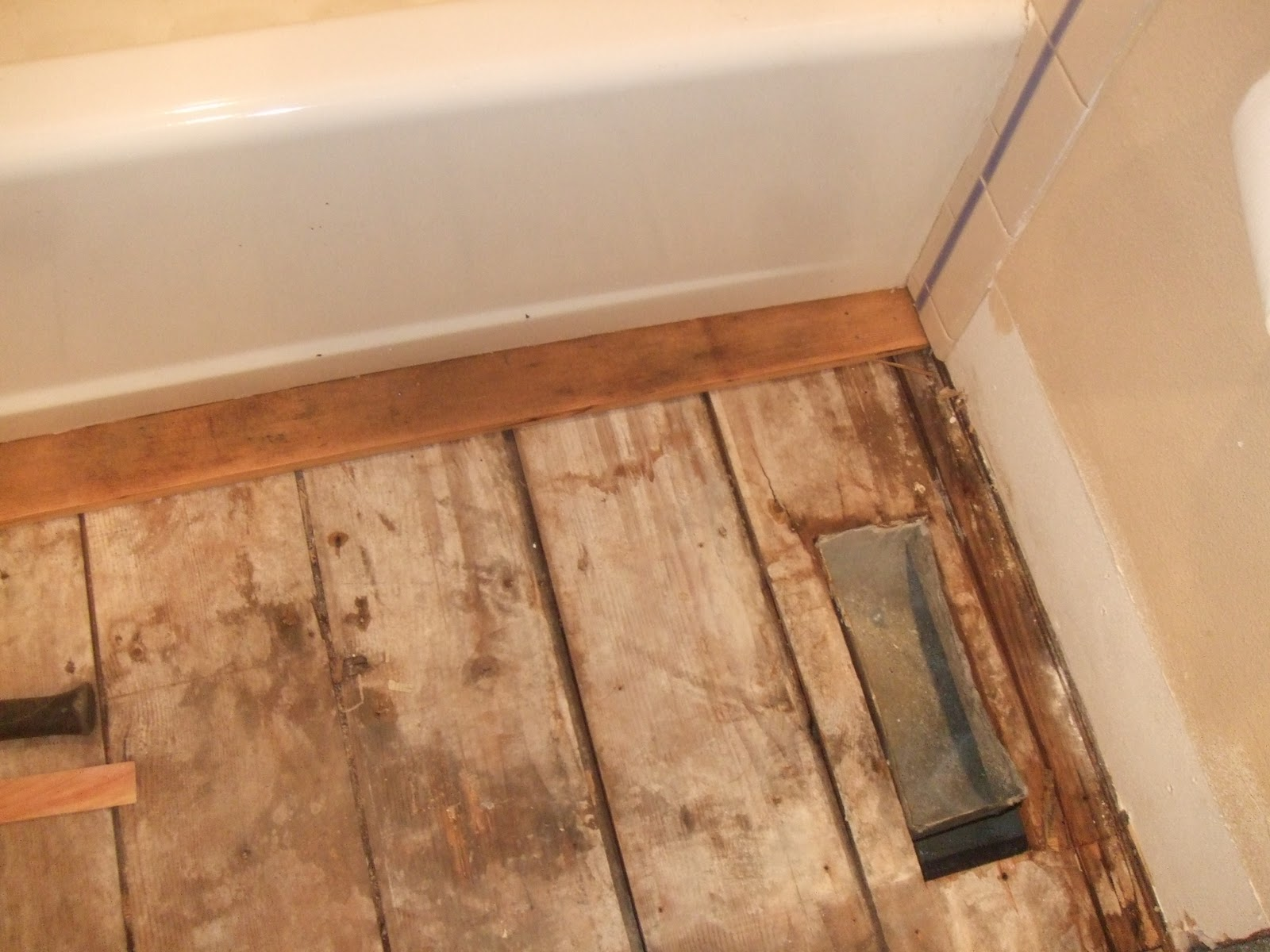 The smiths laying bathroom wood flooring for Laying wood flooring