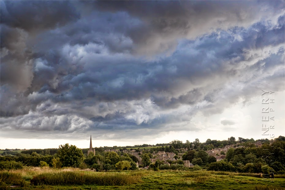 The Cotswold town of Burford and ST Michael's church with dramatic sky