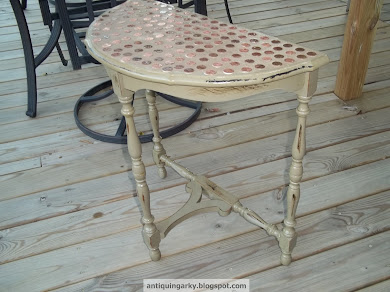 antique table w/ pennies