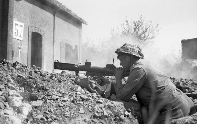 British soldier with PIAT at Saint-Martin-des-Besaces, Basse-Normandie, France, August 1, 1944