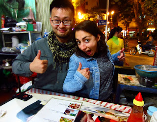 Two tourists pose in a restaurant in Hanoi, Vietnam