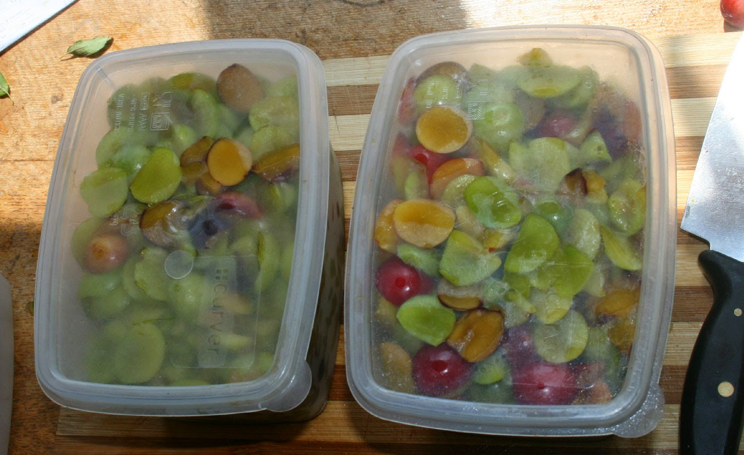 Two big boxes full of prepared plums