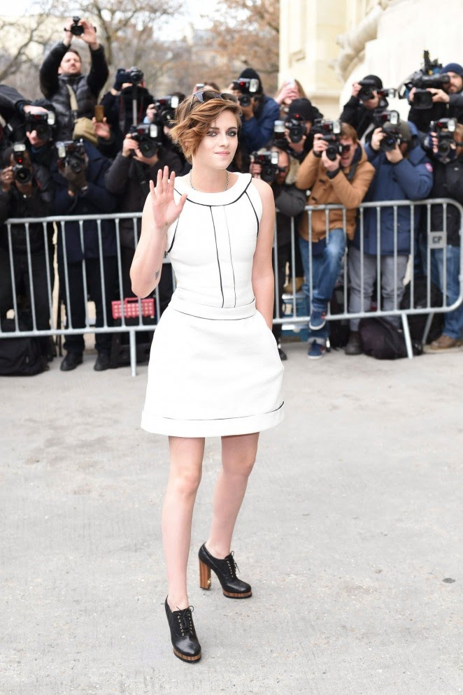 Kristen Stewart in a sleeveless mini dress at the Chanel Haute Couture Spring/Summer 2015 Fashion Show in Paris