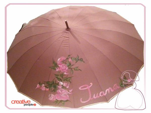 Paraguas pintado a mano sobre fondo rosa Sylvia Lopez Morant modelo Rosas.