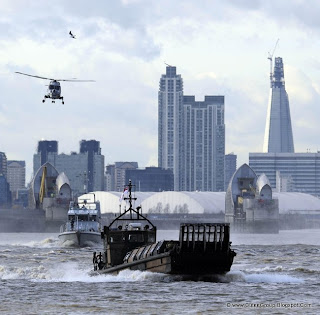 Elite British security teams take to the River Thames as part of a massive security rehearsal to foil terror disaster at the Olympics.