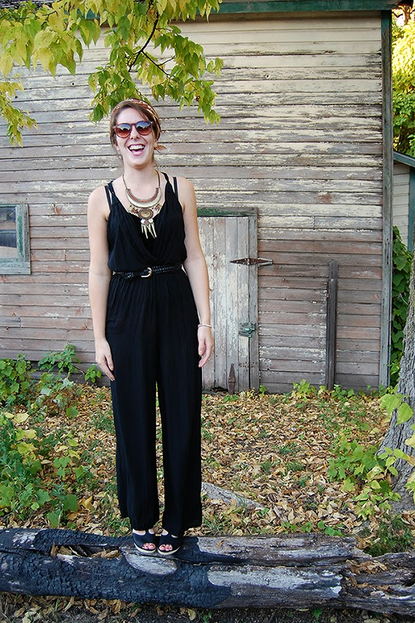 Jumpsuit outfit styled with statement necklace and headscarf.