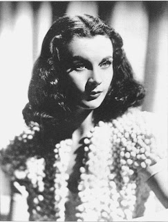 Vintage black and white photo of Vivien Leigh in a white top.