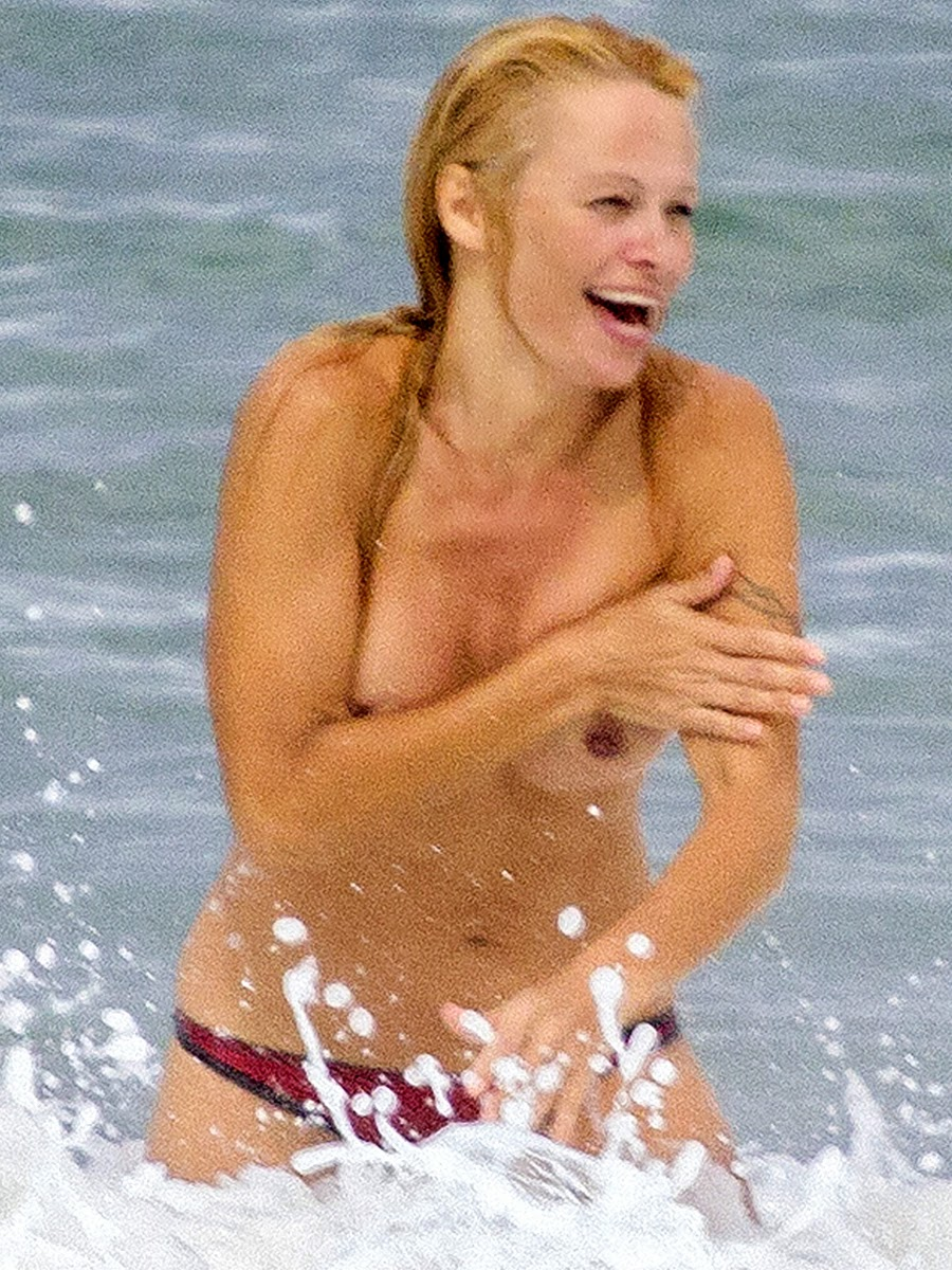 Pamela Anderson Topless Bikini Candid S On A Beach In France
