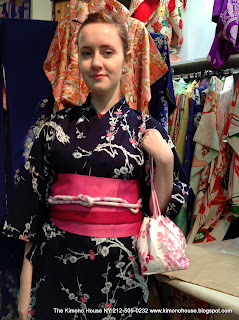 A Young lady wearing a new cotton kimono and obi