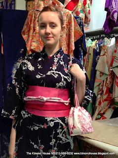 A Young lady wearing a new cotton kimono and obi