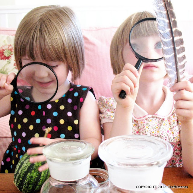 Kids with magnifying glasses