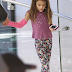 September 2013: Suri Cruise shopping at Apple store