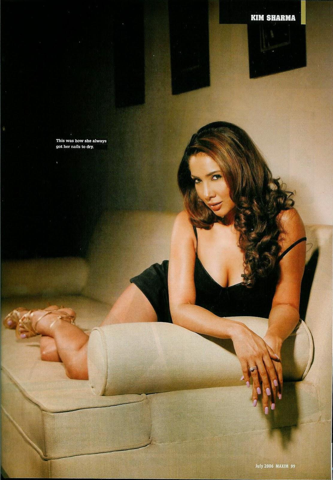 Kim Sharma posing hot in black short dress
