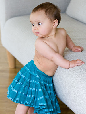 Photo of cute baby girl kid in blue skirt to Download