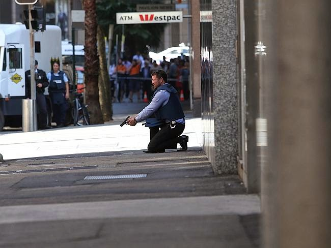http://www.heraldsun.com.au/news/martin-place-siege-hostages-taken-in-lindt-chocolate-shop-by-armed-robber/story-fnii5s3y-1227156245751?nk=f9eadb73bda3525c1cdc9a5f743b2c25