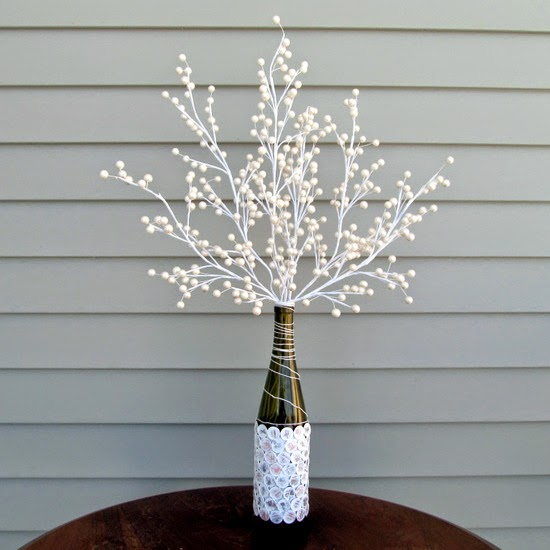 http://muslinandmerlot.blogspot.com/2014/01/diy-penny-vase-with-twist.html
