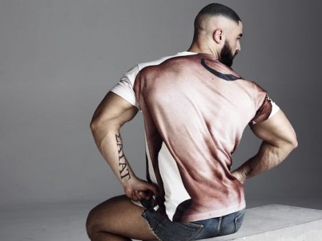 Francois Sagat in denim shorts and KICKSAGAT T-shirt