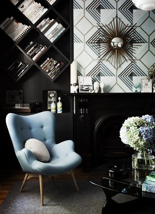 graphic black and white wallpaper and light blue chair