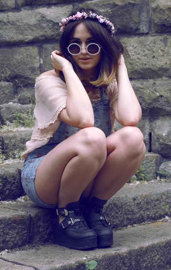 hippy girl, vintage 70s circle sunglasses, wild flower garlands, vintage darling camisole, floral overalls, jeffrey campbell platform boots. sitting down