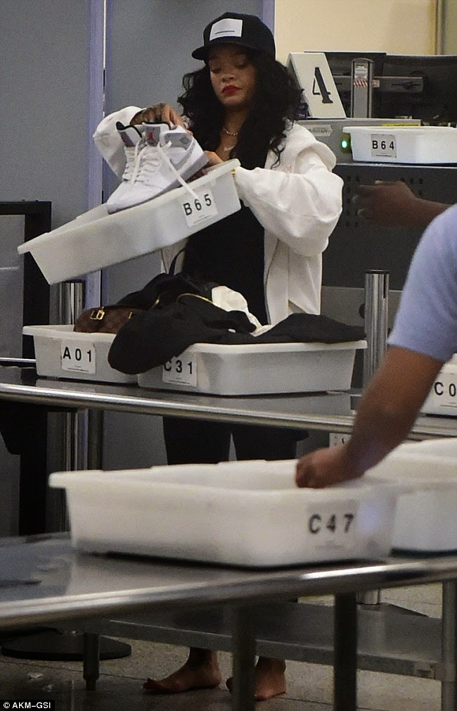 No Superstar Treatment! An Unamused Rihanna Is Thoroughly Checked By Airport Security – Photos