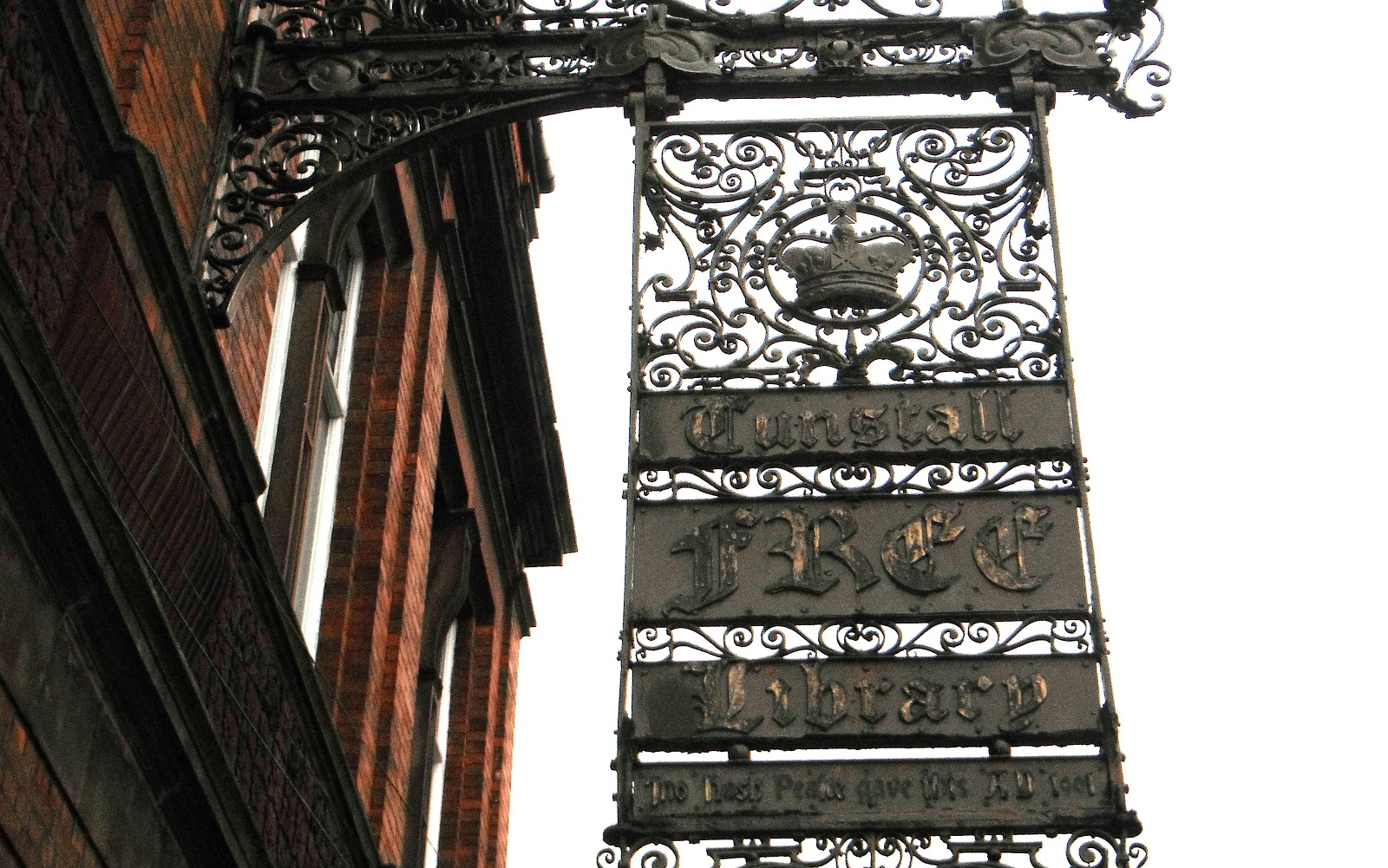 Wrought-iron sign outside Tunstall Library