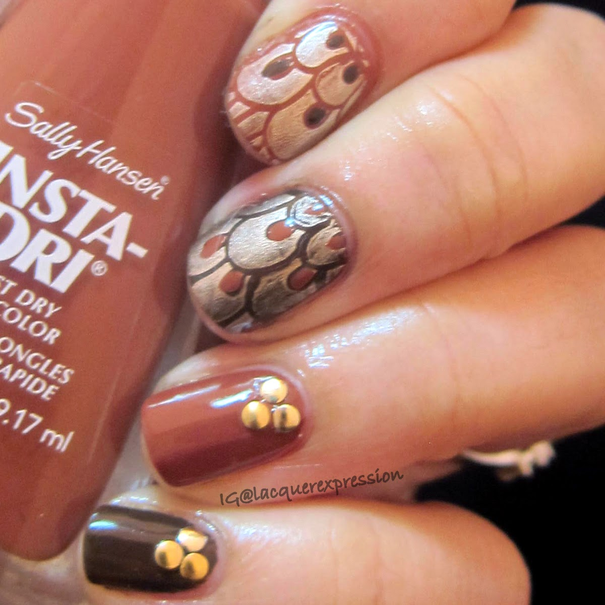 Thanksgiving Feathers nail art using sally hansen moracc-go nail polish