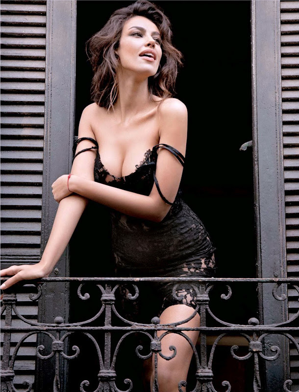 Madalina Ghenea in a night gown on a balcony