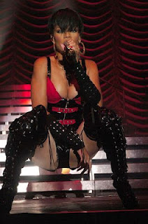 Rihanna on stage in raunchy position