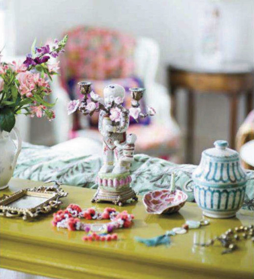 Mette+Gronlykkes+Exotic+Bazaar+Living+Room+Side+Table+Trinkets+and+Vase Brightly Coloured Apartment in Copenhagen