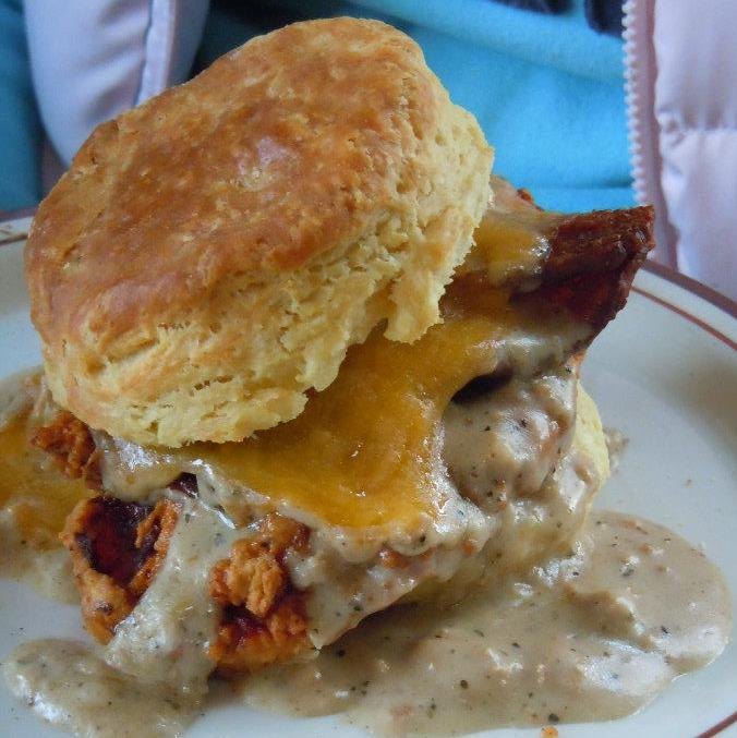 ... with Bacon, Cheddar, Egg and Sausage Gravy on a Flaky Cream Biscuit