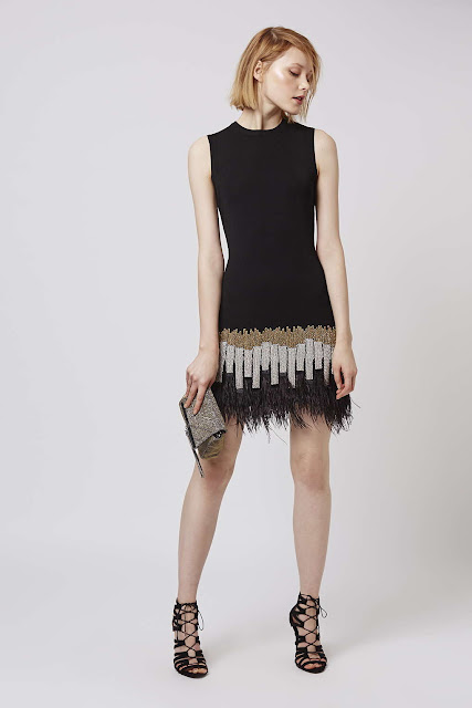black dress feather hem, black feather dress,