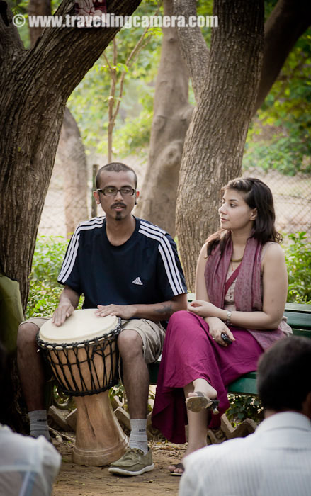 Delhi Drum Circle @ Deer Park, Hauz Khas Village, Delhi, INDIA  : Posted by VJ SHARMA on www.travellingcamera.com : Thanks to Facebook that I got to know about this event and I moved towards this wonderful place called Deer Park in Hauz Khas Village !!! Check out this PHOTO JOURNEY through various drum beats, dance moves, other musical instruments, Enthusiastic people and loads of Fun...Although I don't know many of these folks but all of them were rocking... I was there with Camera but hardly I was able to focus on Photography because their music was amazing and I preferred to enjoy the music instead...Although I don't know many of these folks but all of them were rocking... I was there with Camera but hardly I was able to focus on Photography because their music was amazing and I preferred to enjoy the music instead...It was just the beginning when people started enjoying the music to the core and dancing at the place they were sitting...Initially these folks with drums were settled on the benches arrnged in a Circle and over the time they started moving around & dancing with their drums...
