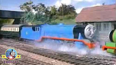 Percy the train engine and big Gordon express stopped with the metal buffer a few inches from his