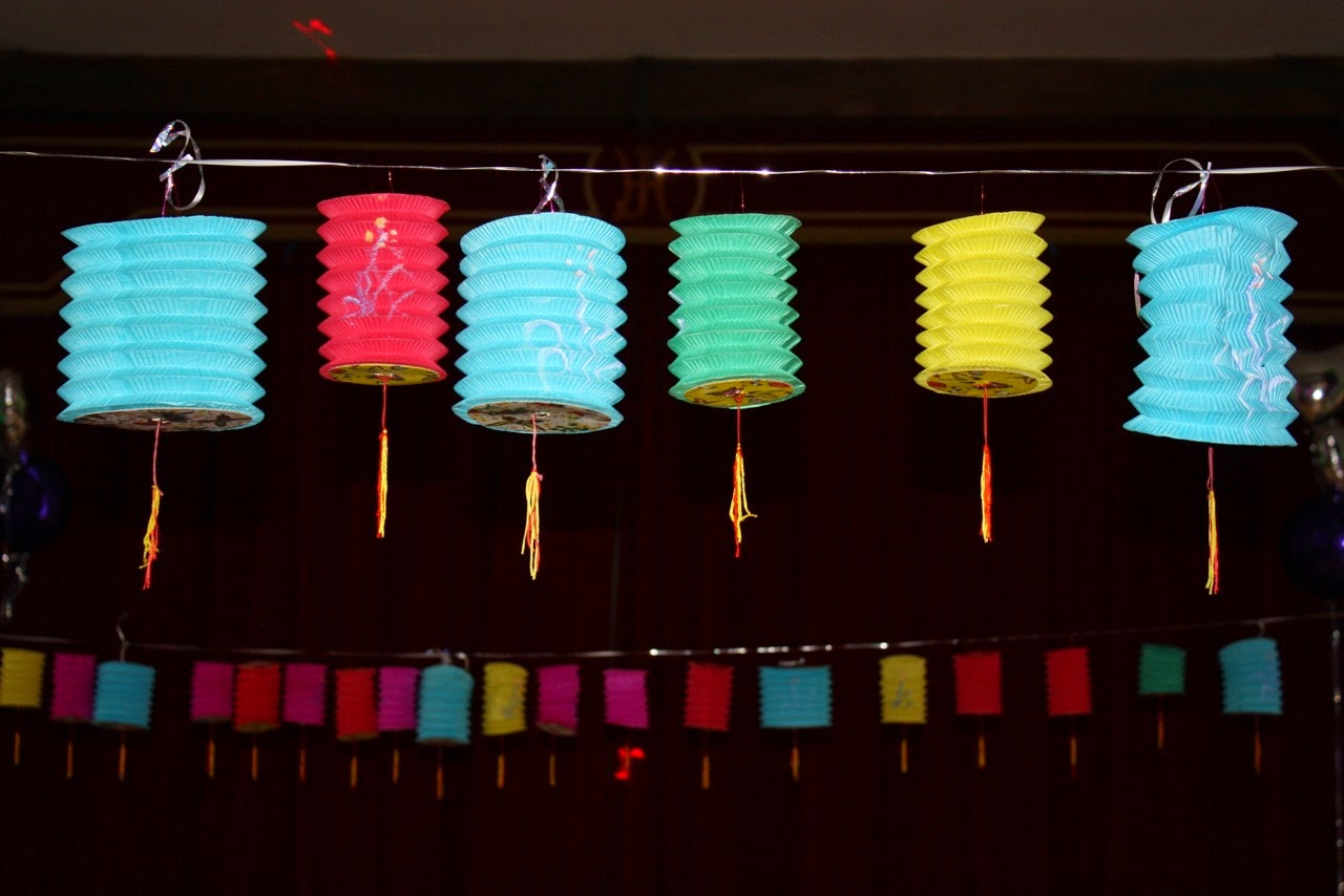 A row of multicoloured Chinese lanterns at a party