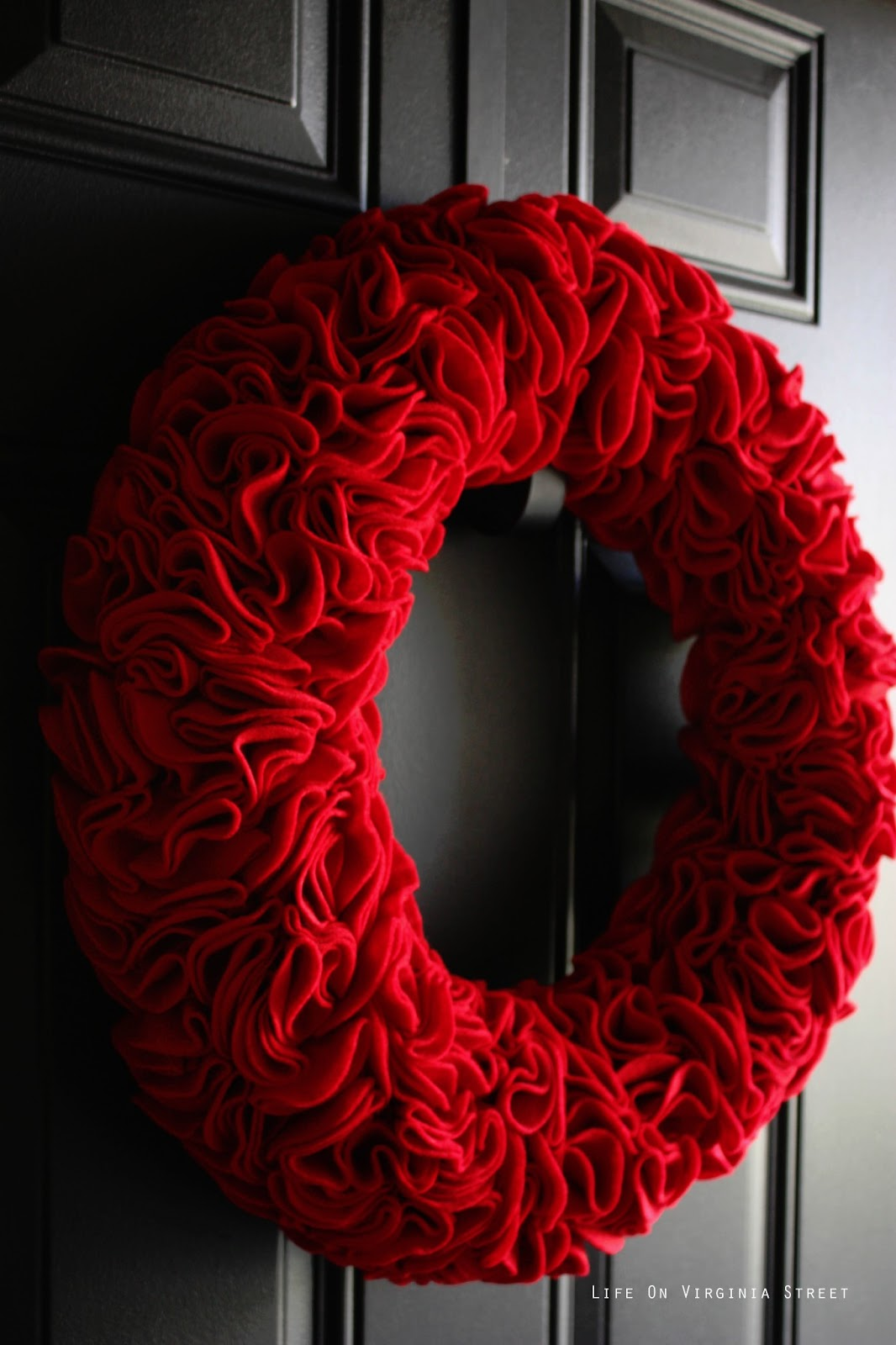 Diy red felt ruffle wreath life on virginia street for How to make christmas door wreaths